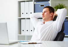Businessman resting in office Royalty Free Stock Image