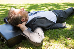 Businessman resting in park Royalty Free Stock Images