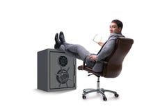 The businessman resting putting leg on safe Stock Photos