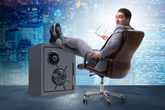 The businessman resting putting leg on safe Royalty Free Stock Photo