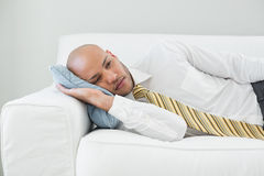 Businessman resting on sofa at home Royalty Free Stock Image
