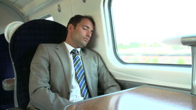 Businessman Resting On Train Journey stock footage