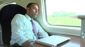 Businessman Resting On Train Journey Royalty Free Stock Photos