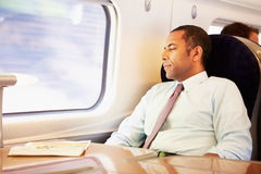 Businessman Resting On Train Royalty Free Stock Image