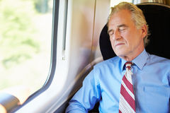 Businessman Resting On Train Stock Photography