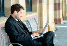 Businessman is resting and using laptop Royalty Free Stock Photo