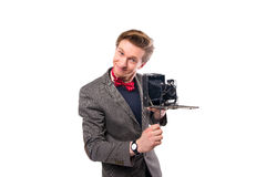 Businessman with a retro camera. White background Royalty Free Stock Images