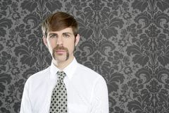 Businessman retro mustache over gray wallpaper Royalty Free Stock Photo