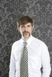 Businessman retro mustache over gray wallpaper. Tie and shirt royalty free stock photo