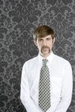 Businessman retro mustache over gray wallpaper Royalty Free Stock Photos