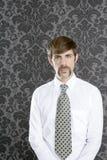 Businessman retro mustache over gray wallpaper Royalty Free Stock Photos
