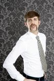 Businessman retro mustache over gray wallpaper Stock Photography