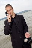 Businessman with retro phone Royalty Free Stock Photos