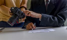 Businessman review picture on camera royalty free stock photos