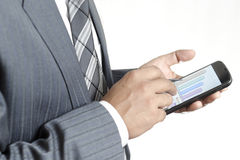 Businessman reviewing data on his smartphone Royalty Free Stock Image