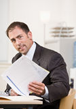 Businessman reviewing paperwork Stock Photo