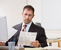 Businessman reviewing paperwork Royalty Free Stock Image
