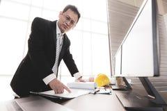 Businessman reviewing plan design royalty free stock photo