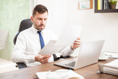 Businessman reviewing some charts Stock Photo