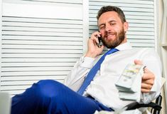 Businessman rich bearded guy sit office with lot of cash money. Bank loan or credit. Get cash in few minutes. Banking. Support line concept. Man successful royalty free stock image