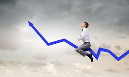 Businessman ride graph Royalty Free Stock Image