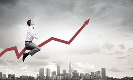 Businessman ride graph Stock Image