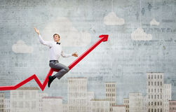 Businessman ride graph Royalty Free Stock Images