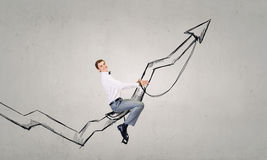 Businessman ride graph Stock Images