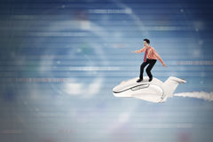 Businessman rides aircraft inside cyberspace Royalty Free Stock Images