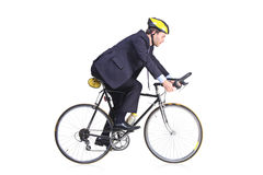 Businessman riding a bicycle. Businessman in a suit riding a bicycle royalty free stock images