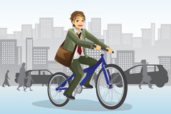 Businessman riding bicycle Royalty Free Stock Photo