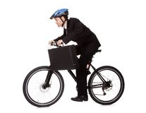 Businessman riding a bicycle royalty free stock photography