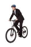 Businessman riding a bicycle Royalty Free Stock Photos