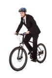 Businessman riding a bicycle royalty free stock photos