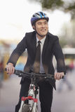 Businessman riding a bicycle, Beijing royalty free stock photography