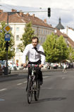 Businessman riding a bicycle in the city Stock Photos