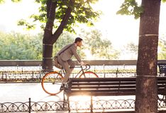 Businessman riding bicycle Stock Photos
