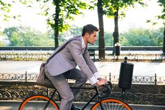 Businessman riding bicycle Royalty Free Stock Images