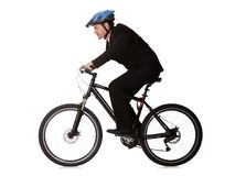 Businessman riding a bicycle Stock Image
