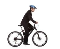 Businessman riding a bicycle Royalty Free Stock Image