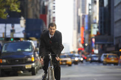 Businessman Riding Bicycle To Work Royalty Free Stock Images
