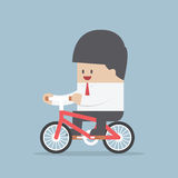 Businessman riding a bicycle to work Royalty Free Stock Photo