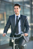 Businessman riding a bicycle to work Royalty Free Stock Photography