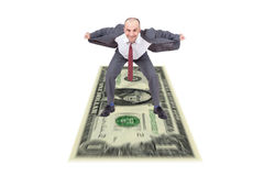 Businessman riding a dollar Royalty Free Stock Photo