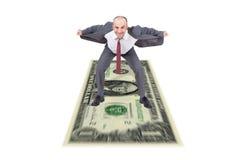 Businessman riding a dollar Royalty Free Stock Photo