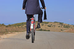 Businessman riding a bike Stock Photo