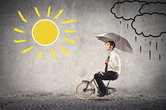 Businessman riding a bike Stock Images