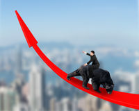 Businessman riding black bear on red arrow up trend line Royalty Free Stock Photography