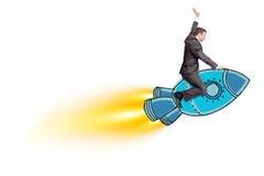 Businessman riding blue rocket Stock Image