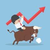Businessman riding on bull Royalty Free Stock Photos